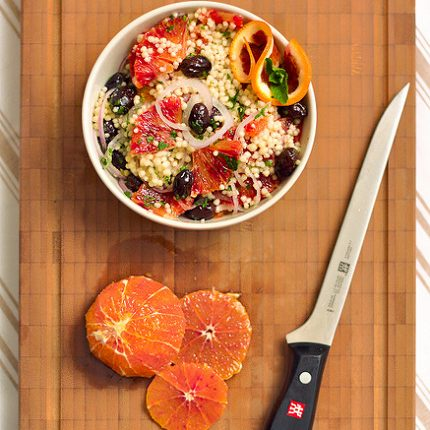 Insalata di cous cous, arance e olive nere